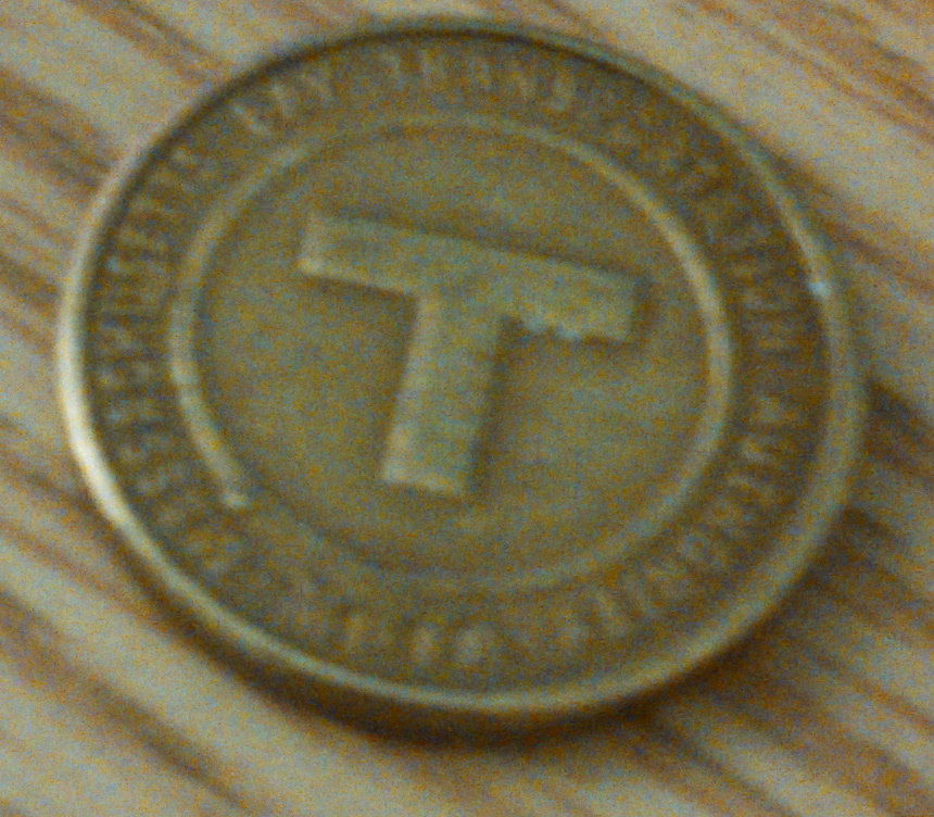 An MBTA token (from the front)